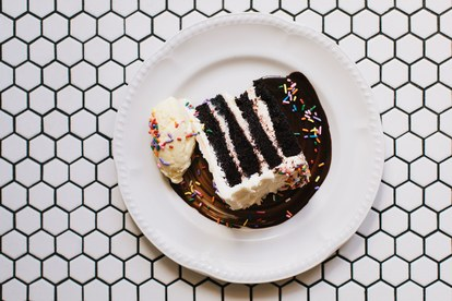 מי cares if it's not your birthday? A slice of sprinkle-topped cake makes any meal here feel like a celebration