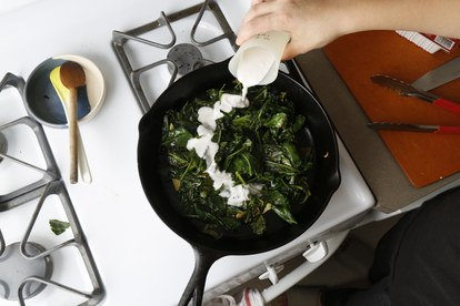 βασικά sweet potatoes cardamom collards coconut milk in pan