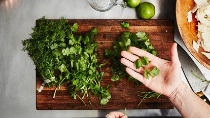 50 dollar dinner party dill cilantro herbs cutting board